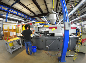 An injection molding press at CY Plastics. The Ontario County, NY manufacturer will add another injection molding press as well as automated handling equipment to support the new agreement and additional growth